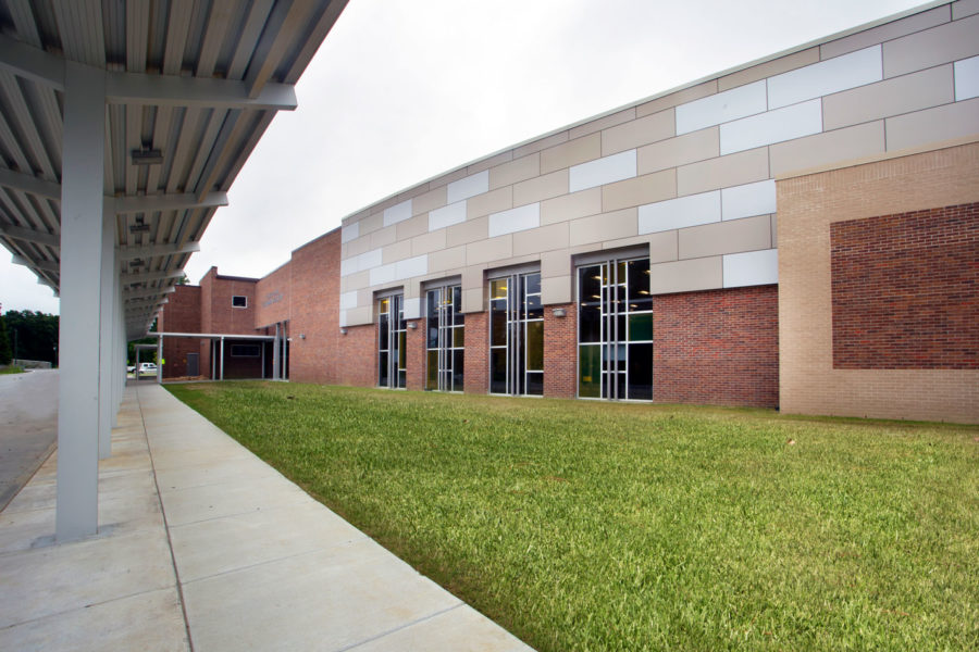 Photo of metal panels and colored glass storefront at St. Amant Freshman Academy