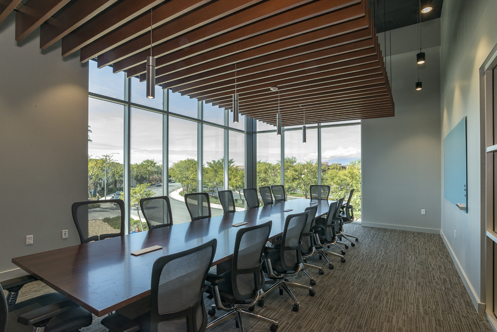 Conference room with large table and windows.