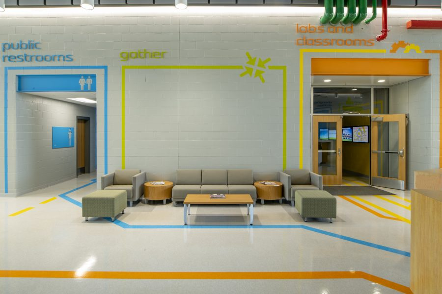 Student common area with bright colors and lounge seating