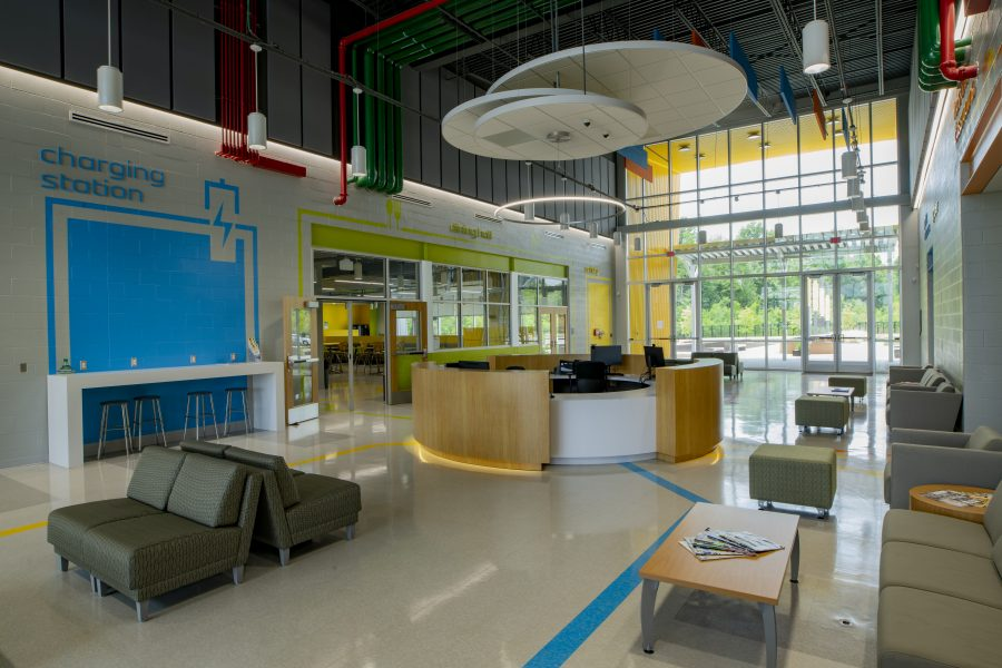 Student Common Area with bright colors, lounging areas, and circular reception desk