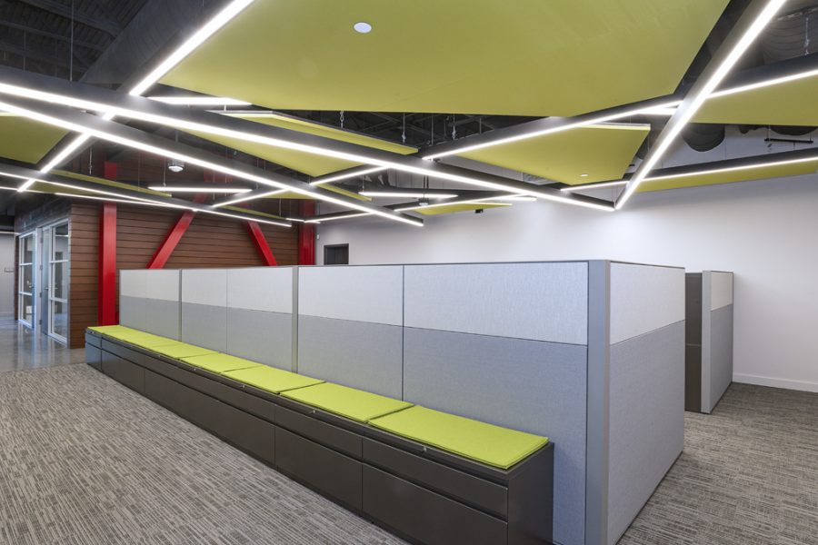 Bright green geometric ceiling and open working spaces.