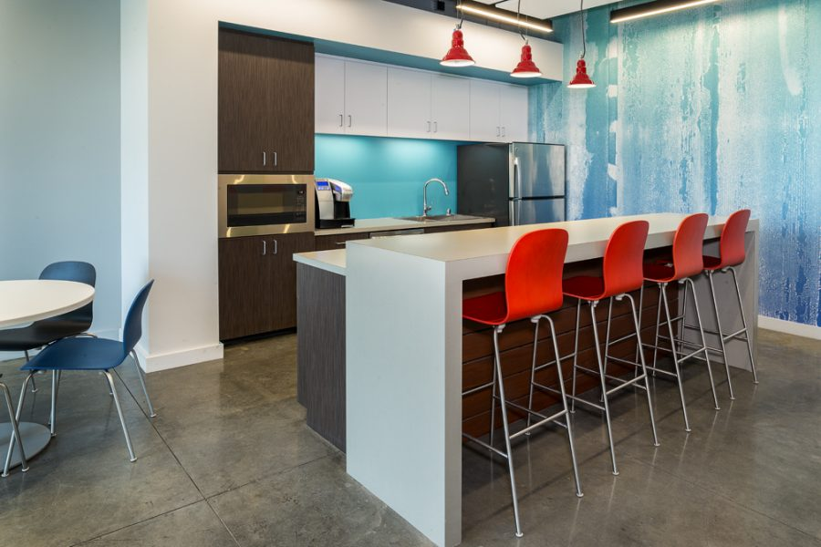 Inviting break room and kitchen with abstract wall covering