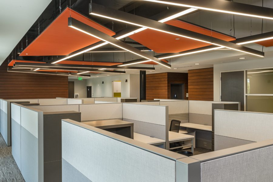 Bright orange geometric ceiling and open work spaces.