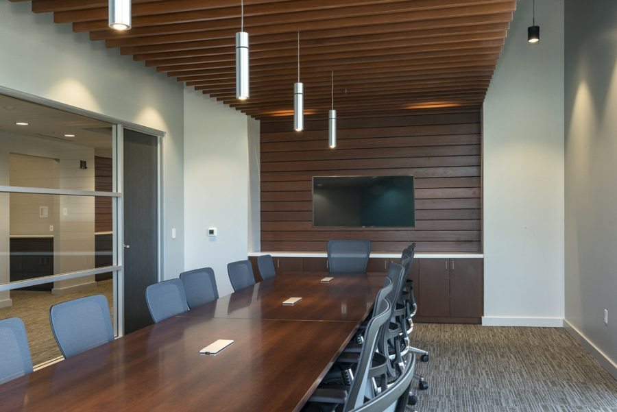 Conference room with redwood accents and large conference table
