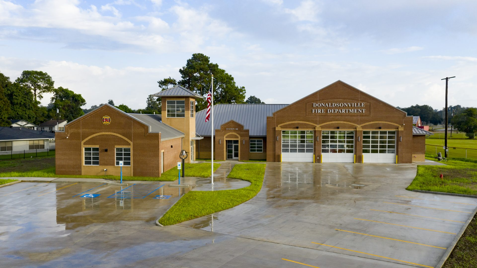 Exterior of the Donaldsonville Fire Station including the parking lot.