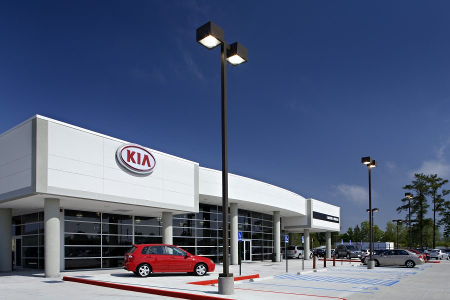 Exterior of All Star Kia during the day.