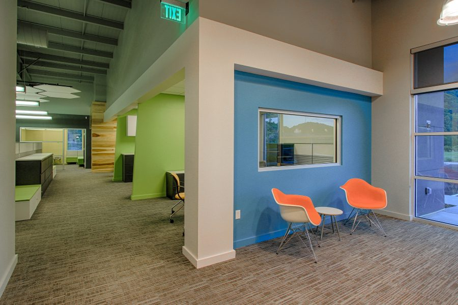 Open and bright lobby area with blue and green accent walls.