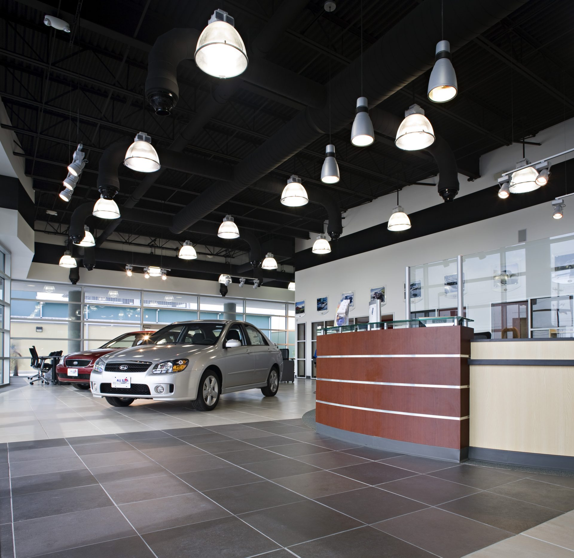 All Star Kia reception area with large, industrial-style lighting.