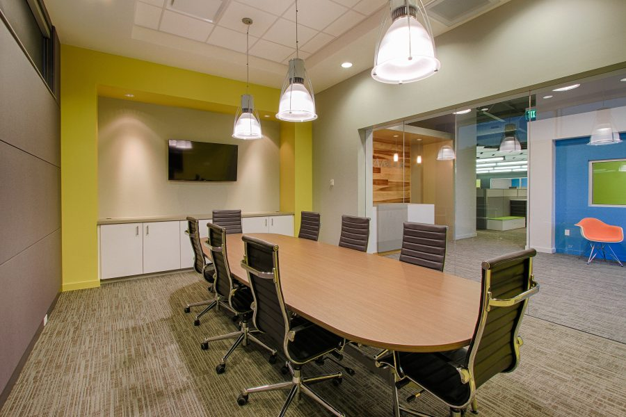 Conference room with table and bright accents.