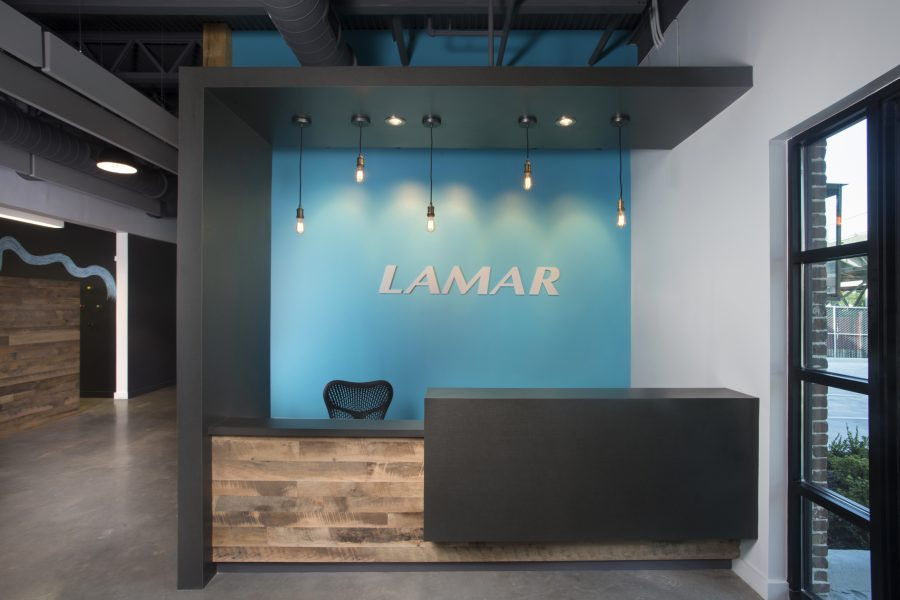 Lamar New Orleans reception area with bright blue wall and edison pendant lights