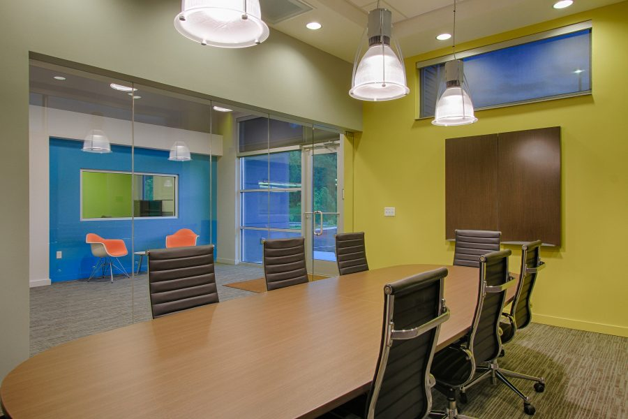 Conference room with bright yellow walls.