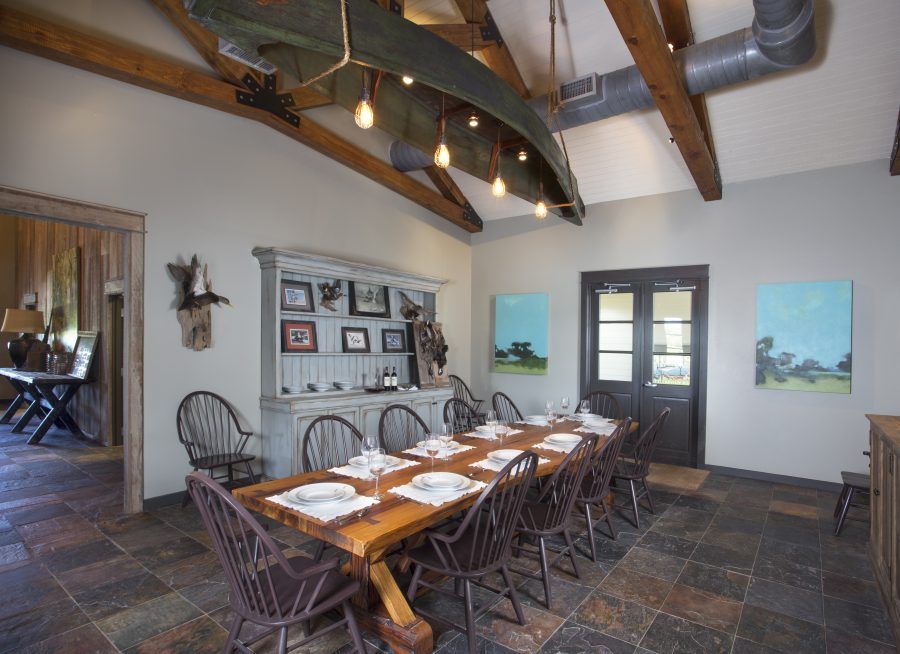 Dining room with large table setting at Lamar's Duck Camp.