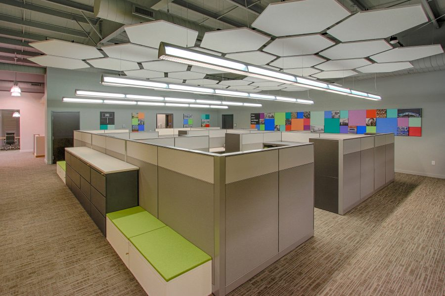 Open office space with hexagon ceiling tiles.