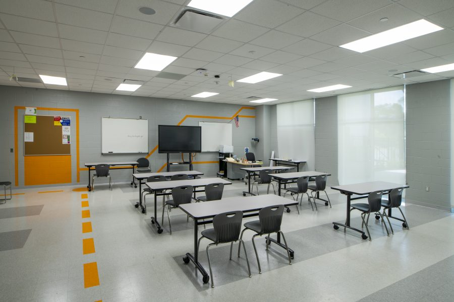 Empty classroom with orange wall graphics