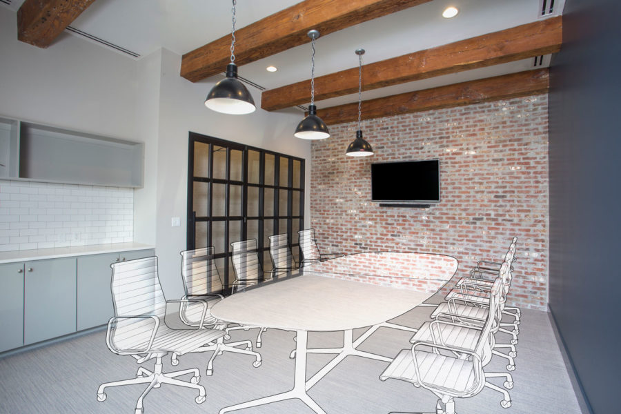 Conference room with black framed storefront, black warehouse pendants, wood beams, and a brick feature wall