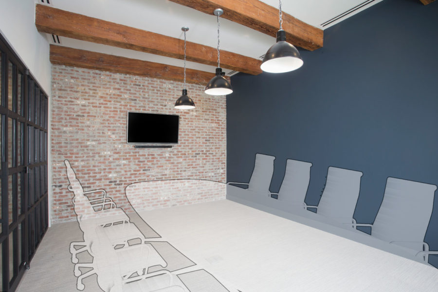 Conference room with brick wall and wooden trusses