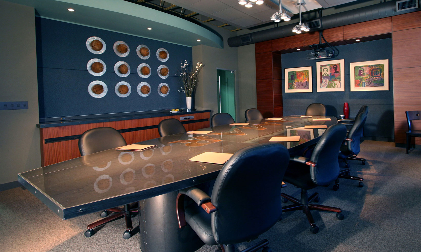 Board room with dark blue and wood accents