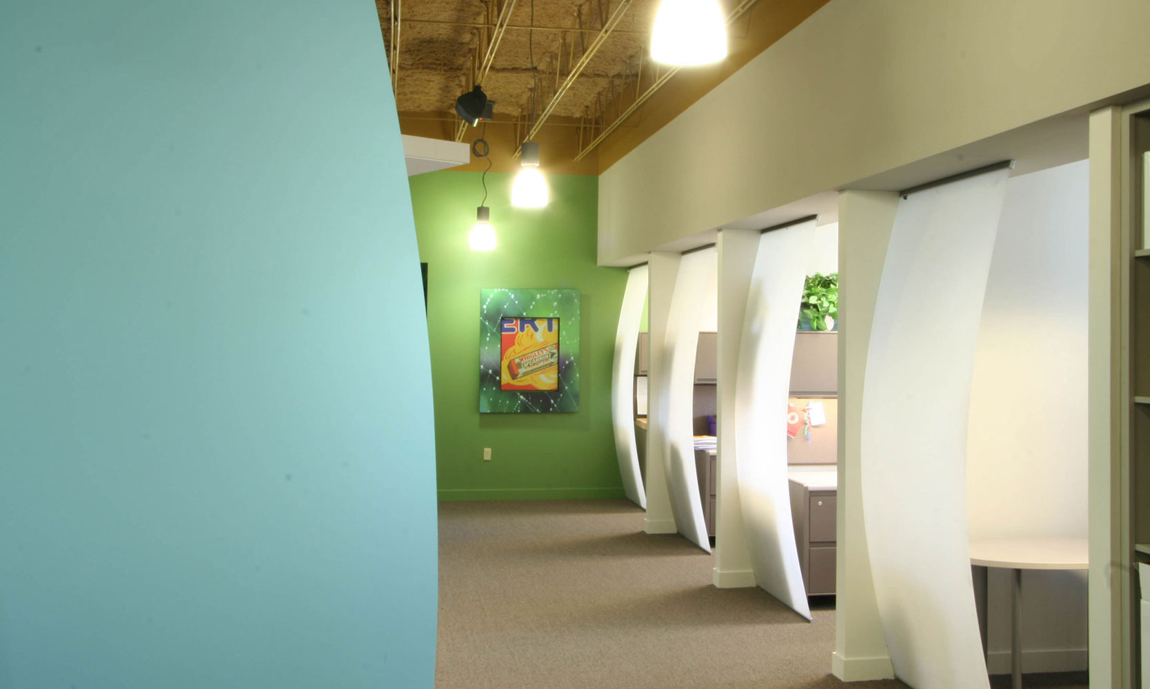 Bright colors in open office spaces with curved glass partitions