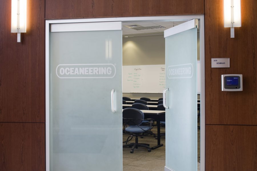 Frosted glass door details with lights at Oceaneering.