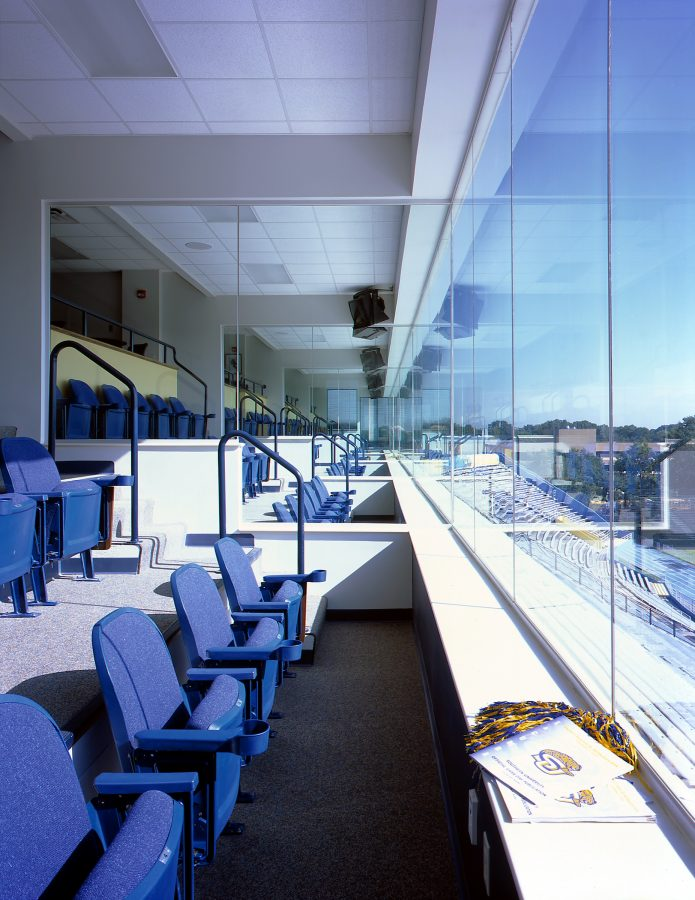 Press box seats overlooking the field.