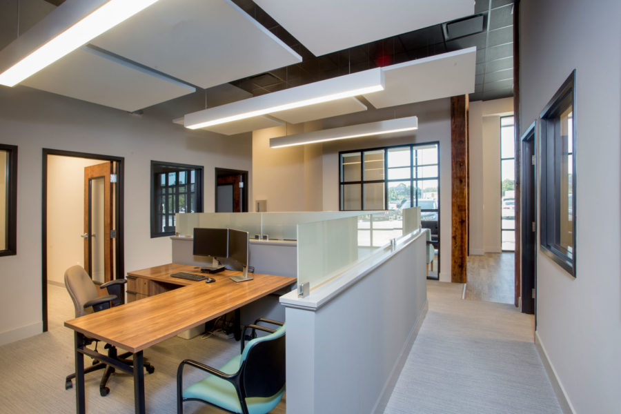 Open cubicles with high ceilings and square acoustical clouds